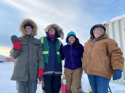 volunteers bundled in cold weather gear for the rummage sale